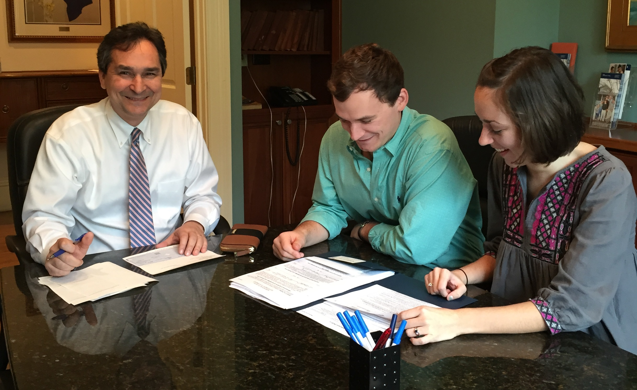 First-time home buyers signing